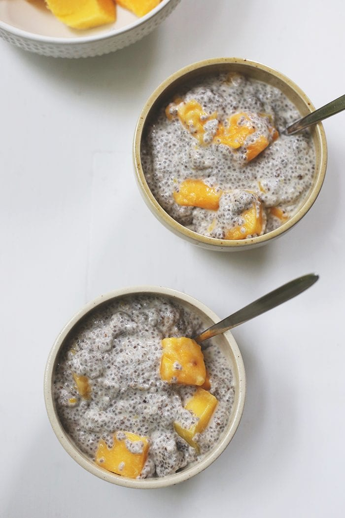 A three-ingredient breakfast or dessert recipe for Mango Coconut Chia Pudding. It's gluten-free, vegan and takes 2 minutes to make. No sugar added and made with healthy fats from chia seeds and coconut milk.