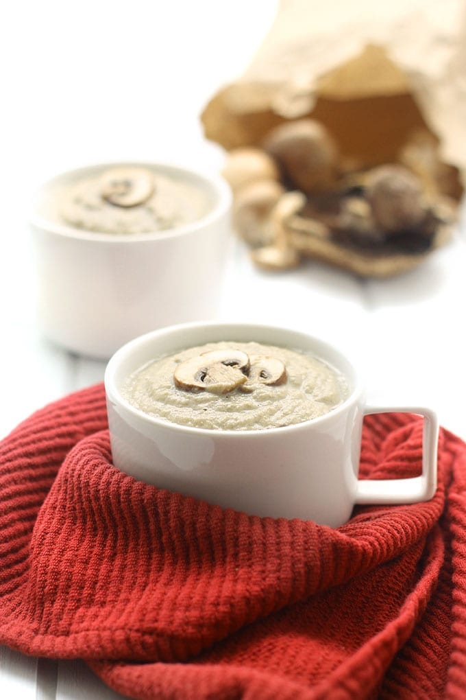 "A delicious dairy-free version of classic cream of mushroom soup where cream is replaced with soaked and blended cashews for a creamy ""creamless"" soup!"