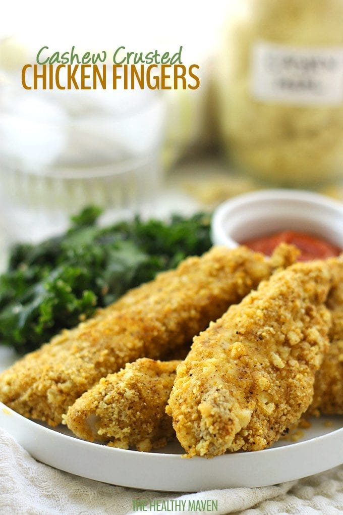 These baked Cashew Crusted Chicken Fingers are perfect for a family friendly weeknight meal or a game day appetizer! They require just 6 ingredients and are ready in less than 30 minutes. Healthy Chicken Fingers never tasted so good.