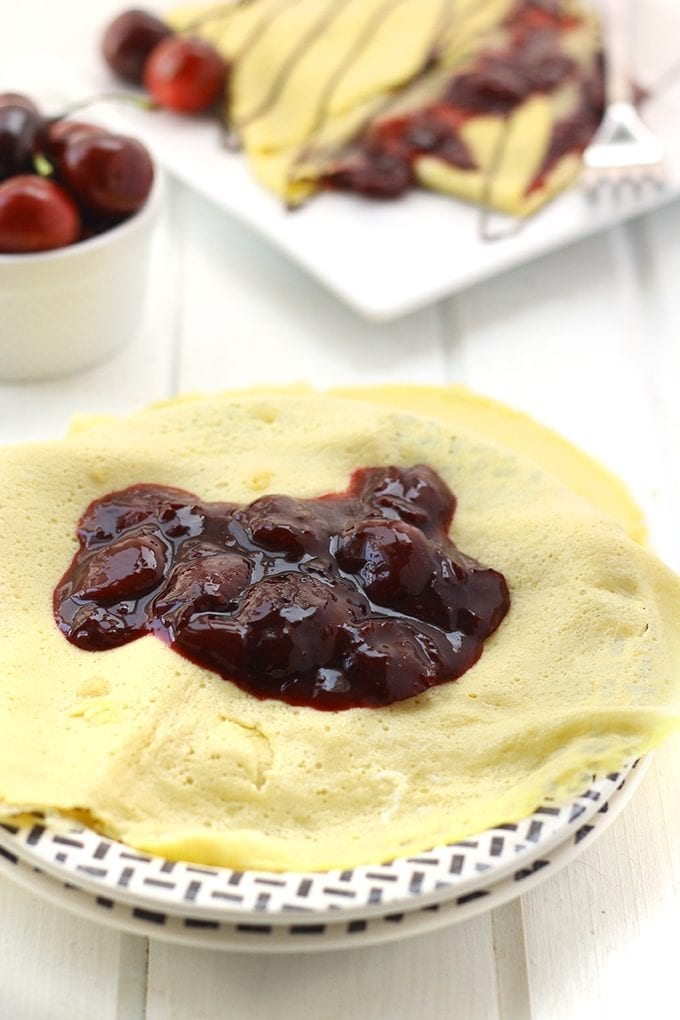 These Chocolate Cherry Crepes are a perfect healthy recipe for breakfast or dessert! With a cherry filling sweetened with honey, a grain-free crepe shell and a light drizzle of chocolate, these crepes will satisfy any sweet tooth.