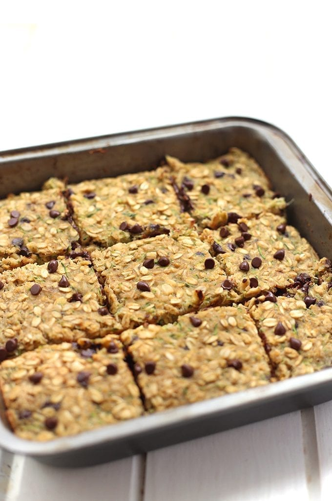 Mix your veggies and chocolate with this healthy Chocolate Chip Zucchini Bread Oatmeal Bars recipe! They're super moist and nutritious but taste like a decadent piece of summer. Plus it's a whole serving of vegetables! Mix your veggies and chocolate with this healthy Chocolate Chip Zucchini Bread Bars recipe! They're super moist and nutritious but taste like a decadent piece of summer. Plus it's a whole serving of vegetables!