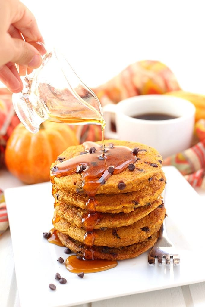 Add some spice to your regular ole' breakfasts with these Pumpkin Chocolate Chip Pancakes. They're entirely gluten-free, made from oat flour and sweetened with just a touch of maple syrup. You will fall head over heels for these fluffy and spicy and pancakes!