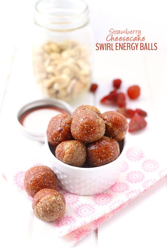 No cheese necessary to make these Strawberry Cheesecake Swirl Energy Balls! Just dried strawberries, nuts and nutritional yeast for a yummy vegan and gluten-free snack recipe.