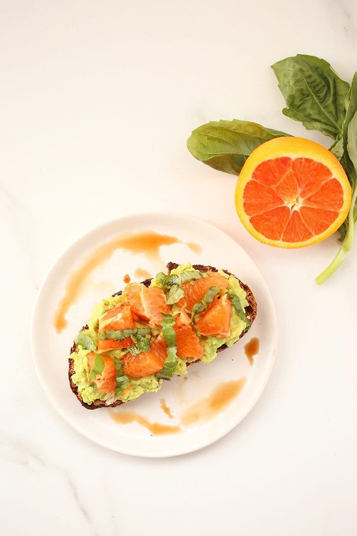 Orange Basil Avocado Toast - Change up your toast game with these Unique Avocado Toast Recipes. Add some spice, flavor and even a sweet twist to kick your avocado toast up a notch! The ultimate healthy breakfast, lunch or snack!