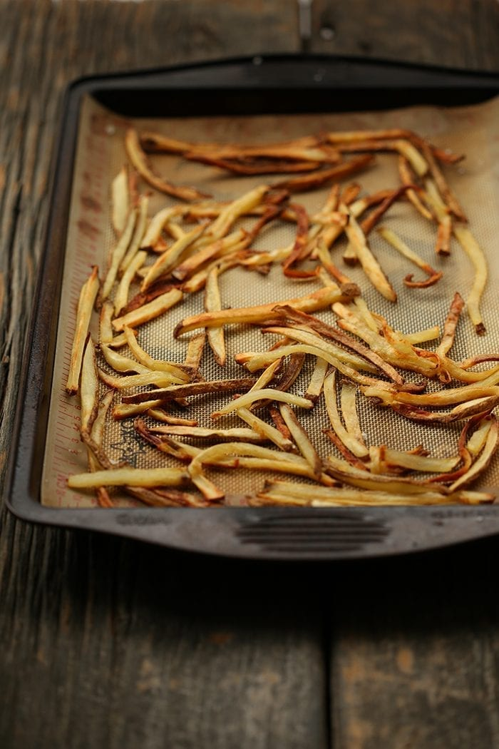 Have you ever wondered how to make crispy baked french fries without them burning? Here's my trick to the ultimate french fries recipe without going near a deep fryer!