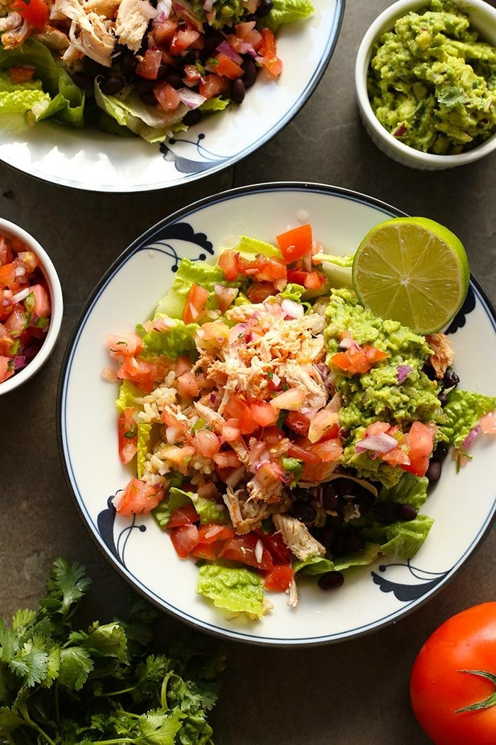 No need for takeout with this Copycat Chipotle Chicken Burrito Bowl! Made just like your favorite restaurant's burrito bowl, this recipe is filling, healthy and the perfect way to use your leftover chicken!