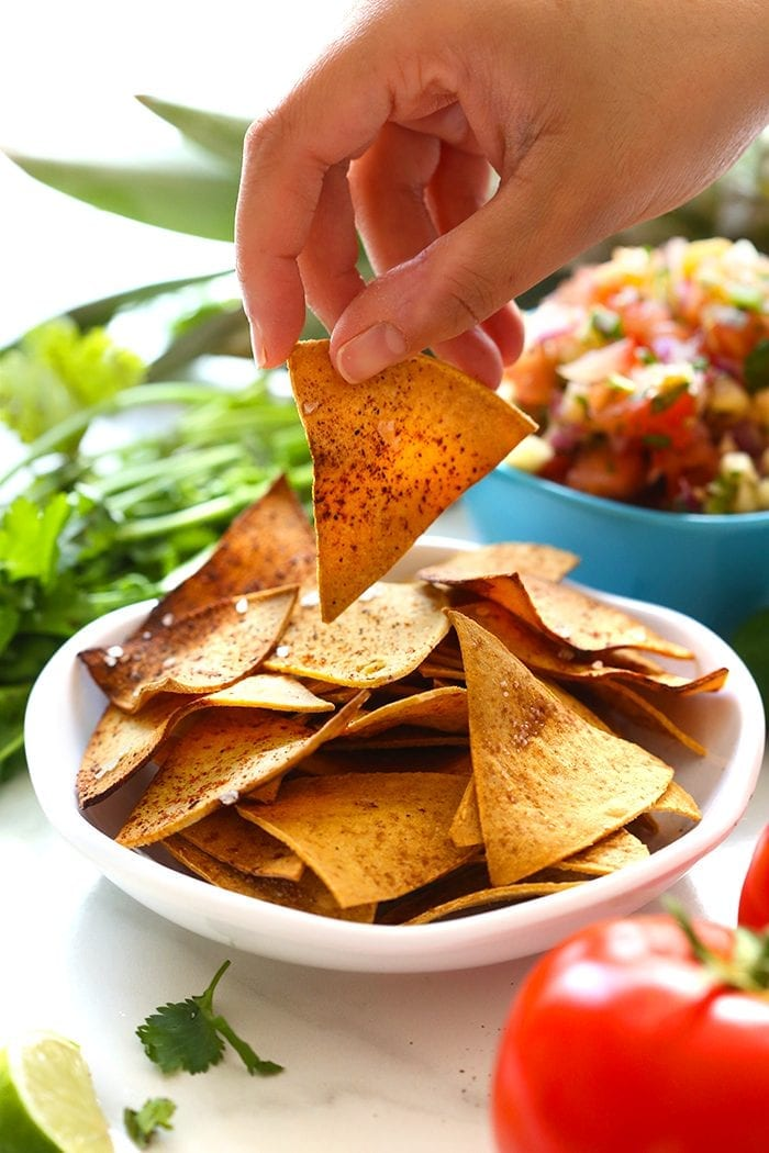 Ditch the processed store-bought chips and learn how to make tortilla chips at home. In three different flavor varieties, you will never need to buy tortilla chips again!