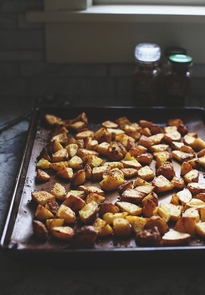 Revisiting an old THM classic with a tutorial on how to make the perfect roasted potatoes. With two variations for when you're in a rush or have more time! They're crispy on the outside and soft on the inside with a delicious spicy coating.