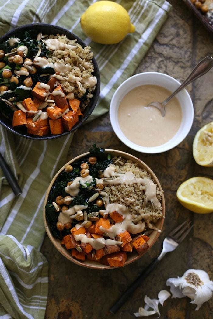 An easy, go-to vegetarian dinner recipe for Macro Veggie Bowls. Made with sweet potato, quinoa, crunchy chickpeas and greens topped with a tahini dressing, this dinner recipe will quickly become a staple at your healthy dinner table.