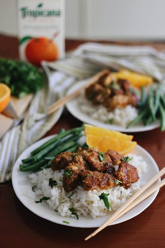 Dinner just got a healthy makeover with this Sticky Orange Chicken Recipe! Made with 100% pure orange juice and organic baked chicken tenders in an almond meal crust, this tangy and sweet dinner recipe is a perfect weeknight meal.