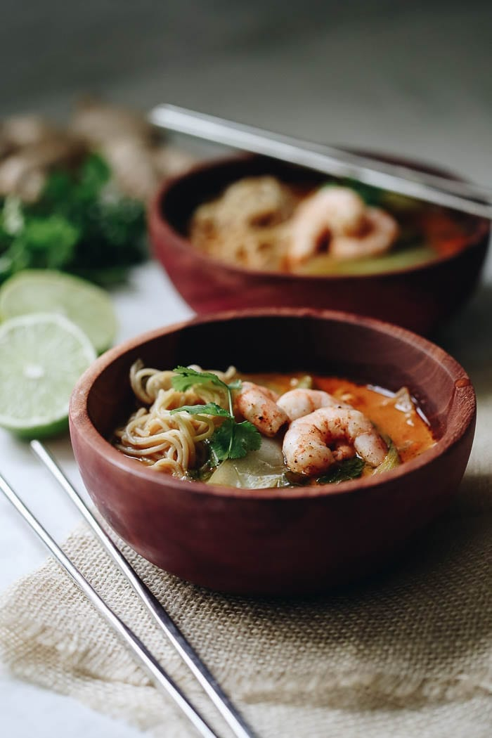 This Curried Thai Coconut Ramen with Shrimp is zesty and spicy with a protein boost from the shrimp and whole-grain, gluten-free noodles. A bone-warming soup recipe that comes together in 40 minutes.