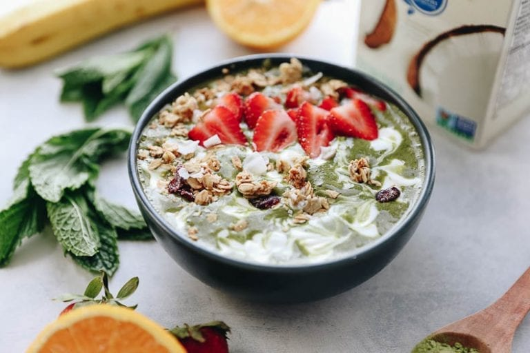 A healthy breakfast recipe made with matcha, fresh mint, banana and coconut milk. This Matcha Mint smoothie bowl is a fun twist on the tropics!