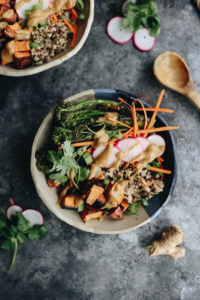 These customizable Quinoa Veggie Bowls with Miso Sesame Dressing will become a weeknight staple. With a quinoa and veggie base topped with a zesty and flavor-packed dressing this easy dinner or lunch recipe is a healthy vegan option for the whole family #quinoa #vegan #bowlrecipe
