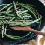 charred green beans on a plate