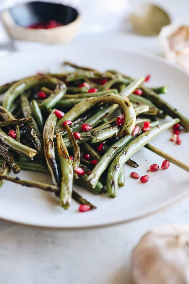 charred green beans with pomegranate seeds