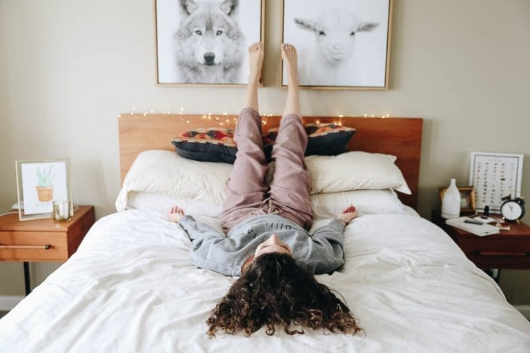 Struggling with sleep issues or looking to build better sleep hygiene? Try yoga for sleep! These yoga poses will help relax your body into a restful night of sleep. #yoga #yogaforsleep #sleep
