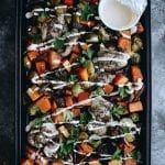 Want a healthy and hearty dinner without all the work? This Tangy Za'atar Chicken with Veggies is made entirely on a sheet-pan for easy clean-up and quick cooking that the whole family can enjoy. Don't forget the spicy yogurt sauce!