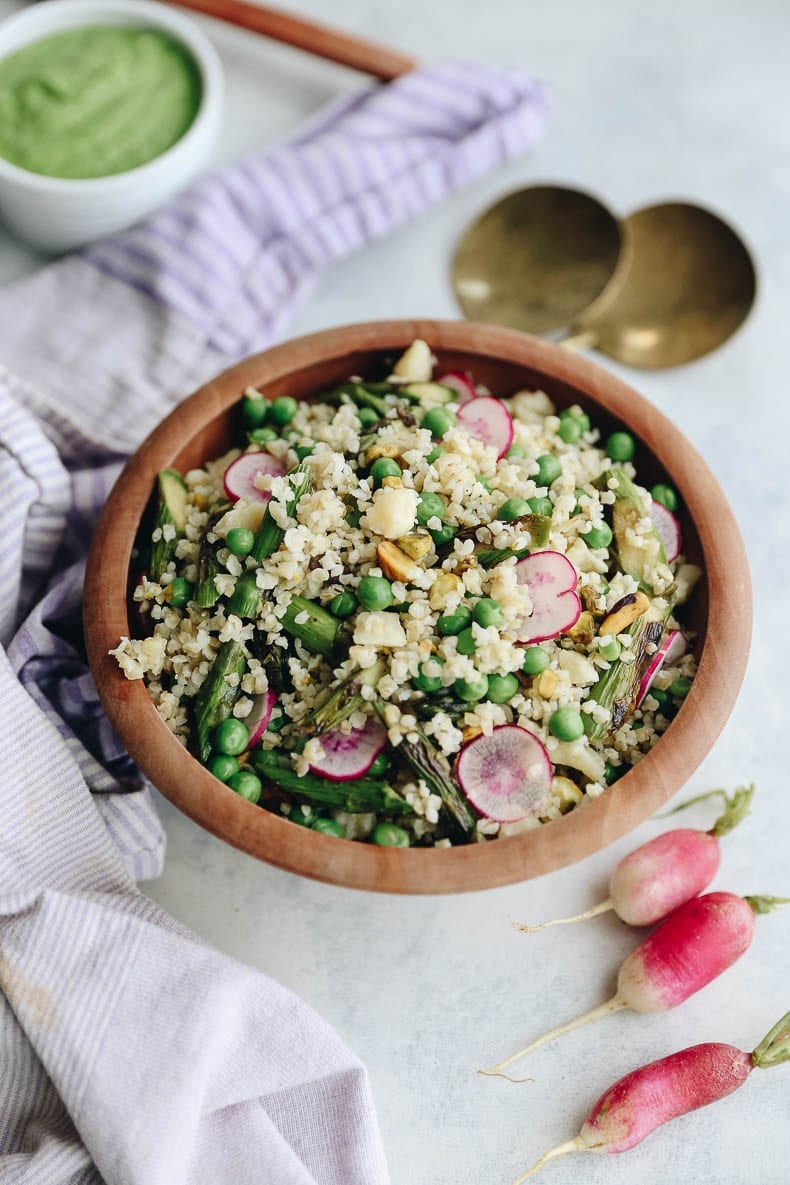 Celebrate the arrival of spring with this Spring Bulgur Wheat Salad with Avocado Herb Dressing. This bulgur salad is simple to make and full of delicious ingredients made from the spring harvest. #bulgurwheat #springsalad