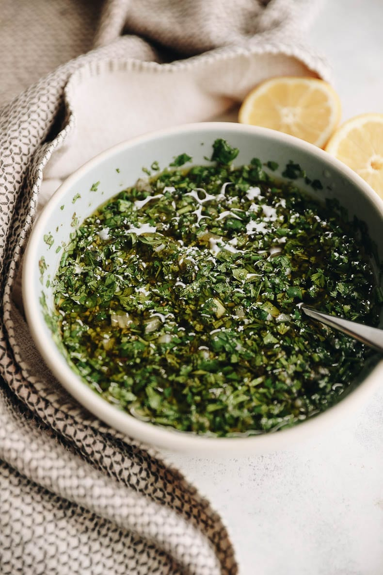 Delicious herby chimichurri for a healthy + easy baked chimichurri salmon recipe #chumichurri #salmon