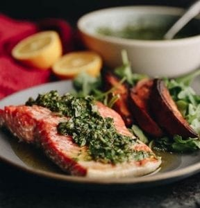 Delicious and healthy baked chimichurri salmon which is ready in under 20 minutes. Perfect for a delicious weeknight dinner #chimichurri #salmon