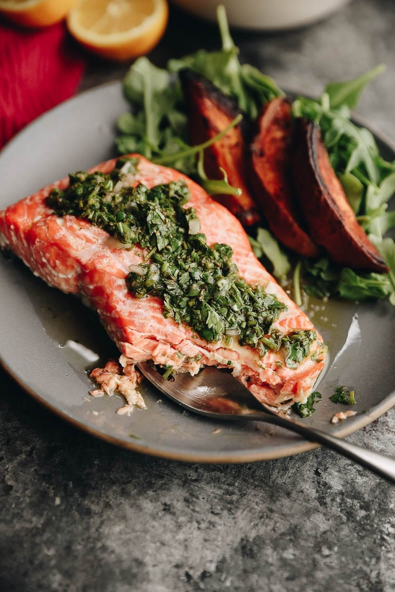 Whip up this Easy Baked Chimichurri Salmon for a delicious and nutirtious weeknight dinner or weekend family meal. All you need is fresh salmon and herbs! #salmon #healthy