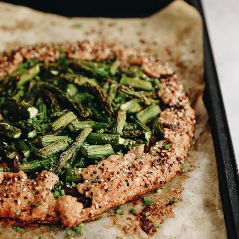 The perfect summer galette recipe made savory with goat cheese, asparagus + caramalized onions #savorygalette #galette