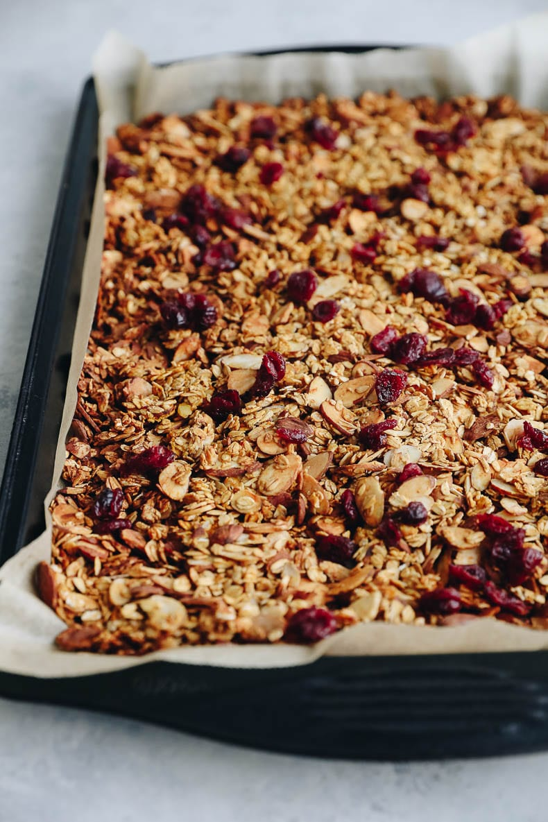 almond cranberry granola on a baking sheet