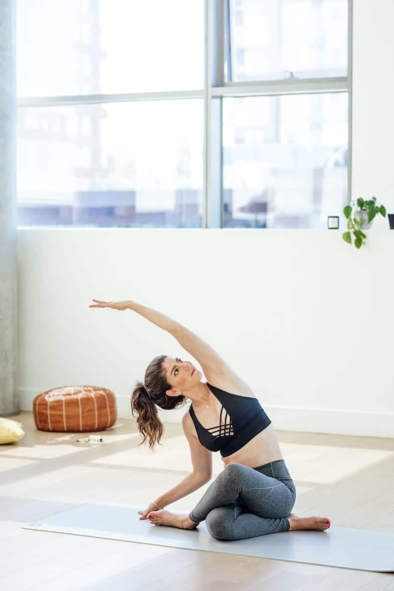 woman with exercise addiction doing yoga