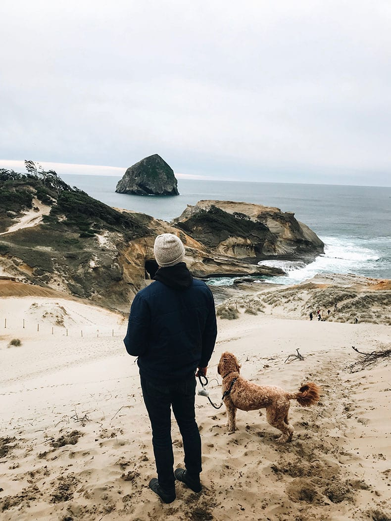 climbing sand dune in cape kiwanda, pacific city, oregon