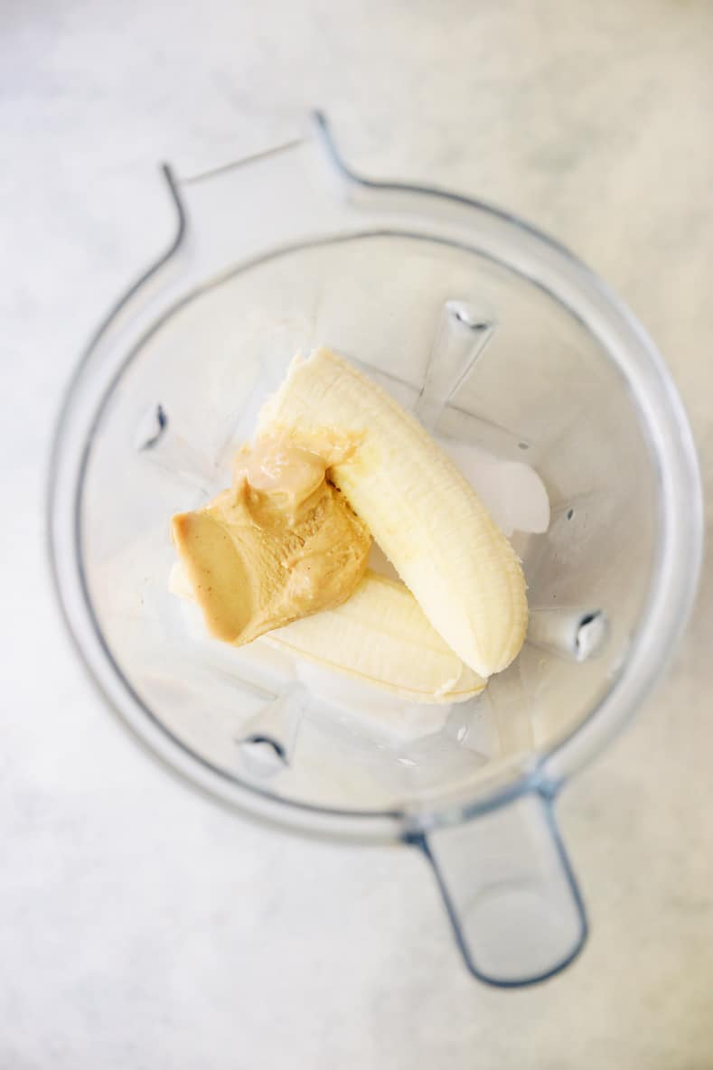 banana peanut butter smoothie ingredients in blender